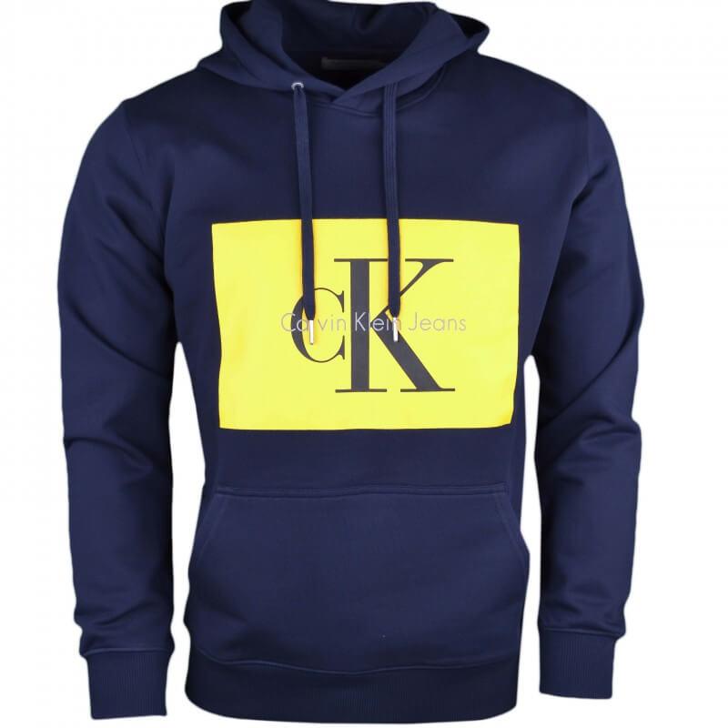 a09bd45744c Sweat à capuche Calvin Klein bleu marine flocage jaune pour homme -...