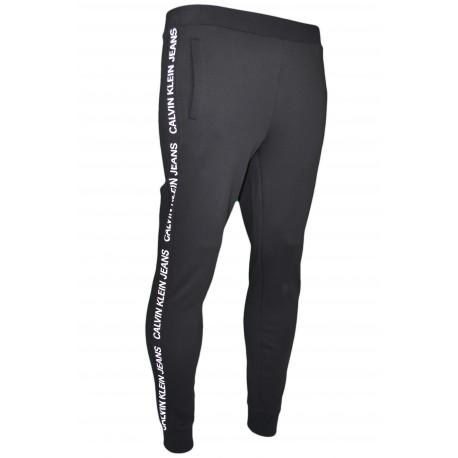 Pantalon jogging Calvin Klein noir galon logo blanc pour femme